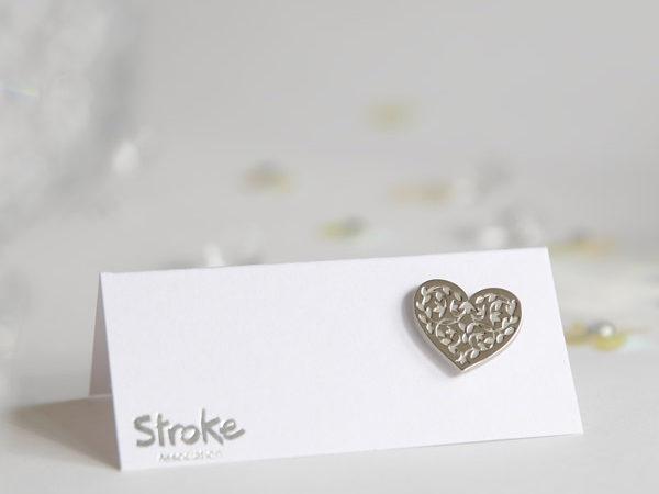 Image of silver heart pin badge