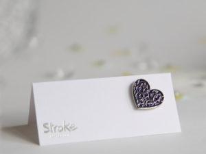 Image of purple heart pin badge