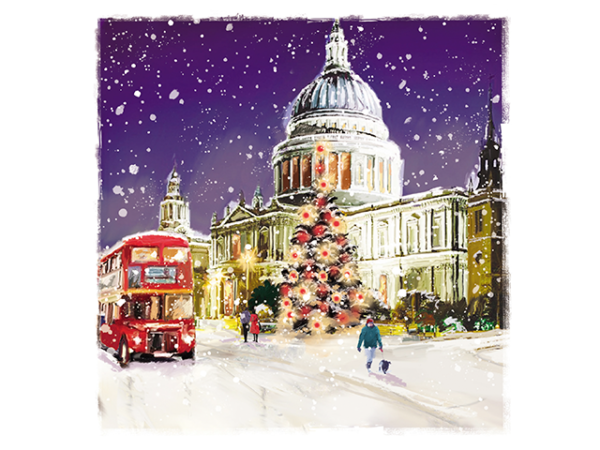St Paul's Cathedral on a snowy winter's night, with a large Xmas tree at the front.