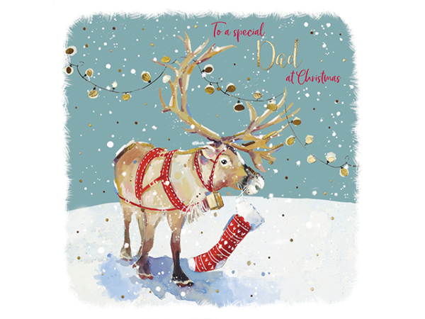A reindeer with festive lights above it and a stocking on its snout.